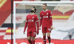Neville mengejek cara penggemar Liverpool bersorak untuk tim tuan rumah